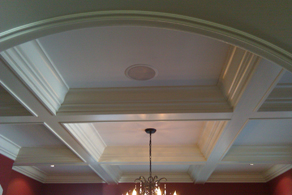 crown molding woodwork on the ceiling